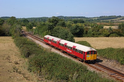 483006 working the 2D37 1449 Ryde Pier Head to Shanklin at Vicarage Lane crossing near Brading on 11 August 2020