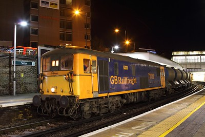 73136 tnt 73128 on the 3W90 Tonbridge west yard circular departing Sutton heading towards New Cross, South Croydon and Balham on the 11th Dec 2016