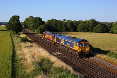 66770 leading 66013 working 6X01 Scunthorpe to Eastleigh yard at Wallers Ash on 17 July 2020  GBRf66, SWML