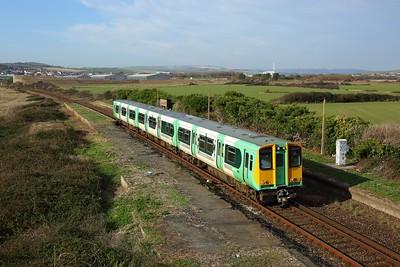 313211 powering 2C26 1141 Brighton to Seaford at Bishopstone Halt, Tide Mills on 6 November 2020