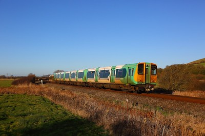 313216 on the 2F66 1357 Seaford to Brighton near Southease on the 28th December 2017