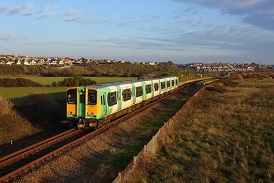 313211 working 2C43 1525 Seaford to Brighton departing Bishopstone Halt, Tide Mills on 6 November 2020