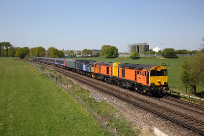 20311 leads 20314 with 47813 DIT on 5O86 Ely to Eastleigh nearing Virginia Water on the 20th April 2020. ** Please note, picture taken with land owner permission **