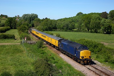 37612 in Plain DRS blue leads 37610 on 1Z22 0820 Tyseley TMD to Bristol High level sidings test train via Weymouth departing Yetminster on the Heart of Wessex line on 20 May 2020