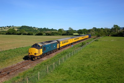 Br Small logo blue 37610 leads Plain DRS blue 37612 on 1Z22 0820 Tyseley TMD to Bristol High level sidings test train at Thornford on the Heart of Wessex line on 20 May 2020