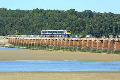 170105 forms 1H57 1056 Barrow in Furness-Manchester Airport on 08/09/2004 seen here crossing Kent Viaduct, Arnside.