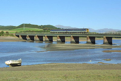 An unidentified class 156 Sprinter crosses Eskmeals Viaduct on 08/09/2004 with 2C37 1421 Barrow in Furness-Carlisle.