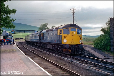 After 26015 had been removed, 26040 stands at Achnasheen awaiting departure with 2K02 0655 Inverness-Wick on 21/07/1983.