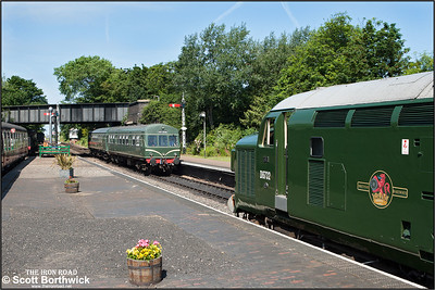 D6732 (37032) awaits the road as 56062/51192 arrive at Sheringham with the 1030 Holt-Sheringham service on 12/06/2014.