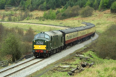 37261 works the 1620 Pickering-Grosmont service through Newtondale at Carters House on 23/04/2004.