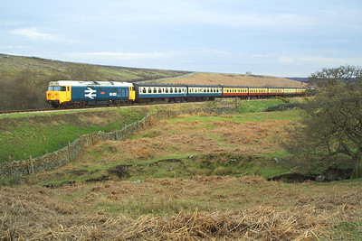 50033 heads the 1820 Pickering-Grosmont service at Moorgates on 23/04/2004. 50007 is on the rear.