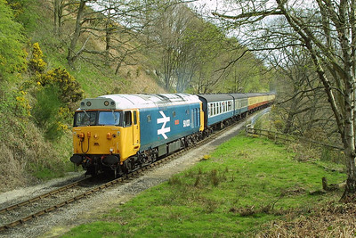 50033 is pictured working the 1220 Pickering-Grosmont at Beck Hole on 23/04/2004. 50007 is on the rear of the train.