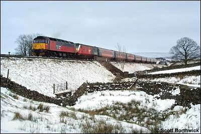 47773 'Reservist' nears Ais Gill summit whilst in charge of 1S57 0930 London Euston-Glasgow Central on 23/02/2002. The locomotive was appropriately fitted with miniature snowploughs.