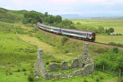 156493+156499 pass the ruins at Kinloid with the 0812 Glasgow Queen Street-Mallaig service on 03/08/2002. The flat topped Inner Hebridean island of Eigg (with Rum behind it) is just visible in the distance across the Sound of Sleat.