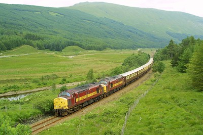 After a very sociable evening in the bar at Tyndrum with several members of the EMRPS, a morning hike was in order to clear the head. Here 37427+37411 power 1Z64 0910 Edinburgh-Oban 'Northern Belle' through Glen Lochy on 04/08/2002. After the shot was in the can the chase was on. Some of us walked back to the cars, some jogged, and more than one person actually sprinted. Passengers on the train had paid £170 per head for their dining experience, which also included a trip to the Isle of Mull.