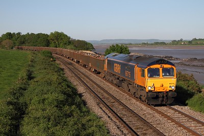 66715 powers the 6Z30 Handsworth to Cardiff Tidal loaded scrap at Purton, running in an earlier path  25 05 2012