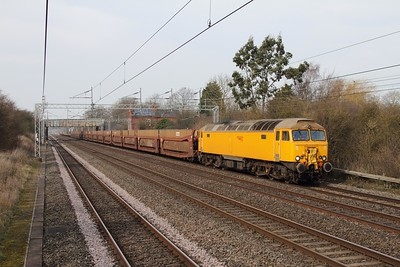 57306 currently on hire to GBRf works the 6Z80 Warrington Arpley to Tonbridge empty cartics at Cathiron just north of Rugby on the 8th March 2014