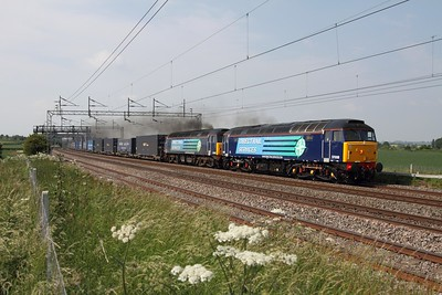 57008 leads 57010 on 4M44 Mossend to Daventry, sounding and looking tremendous at Grendon (south of Polesworth) on 19th June 2013  57010 failed at Daventry so the return was 37s from Crewe