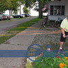 Donna Mackin, long time resident, getting her small flags out.