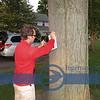 Kyle Eberhardt, hammering in directional signs.