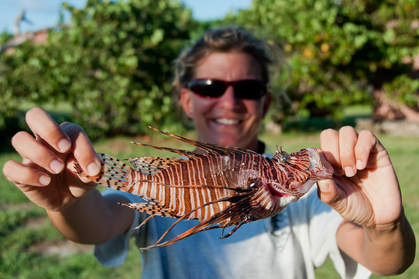 An NPS biologist displays her catch--one less invasive lionfish in Dry Tortugas National Park.