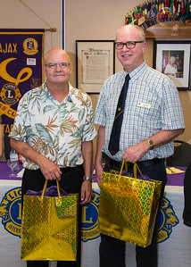 Lion Gary Wilson and Lion Jim Fair with their token of appreciation from Lion President Micheline Lush