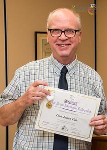 """Lion James Fair with his """"Judge Brian Stevenson Fellowship"""""""