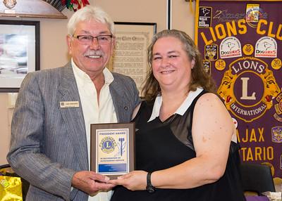 "Lion Len Crocker presenting the ""President Award"" to Lion Micheline Lush"
