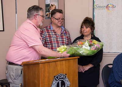 Lion Don and Lion Louis presenting our caterer Pauline White with some lovely flowers