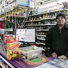 Jay's Liquors employee Pankaj Patel wait for customers at their store in Fitchburg. SENTINEL & ENTERPRISE/JOHN LIOVE