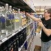 Stocking shelves at Wyman's Liquors in Fitchburg Friday, March 20, 2020 is Assistant Manager Sean Heinold. SENTINEL & ENTERPRISE/JOHN LIOVE