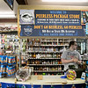 Marcus Rupelt manager at Peerless Liquors in Fitchburg waits for customers Friday, March 20, 2020. SENTINEL & ENTERPRISE/JOHN LIOVE