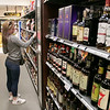 Wyman's Liquors in Fitchburg Friday, March 20, 2020. Picking out some liquor is Cherry Diabo of Fitchburg. SENTINEL & ENTERPRISE/JOHN LIOVE