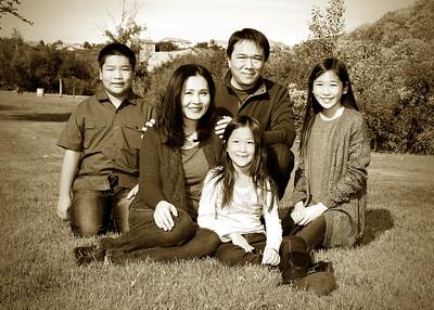 family on grass sepia