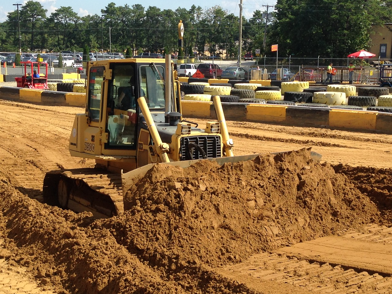 The trick is to keep the blade low enough to keep gathering dirt, but high enough that the dozer can keep moving forward.