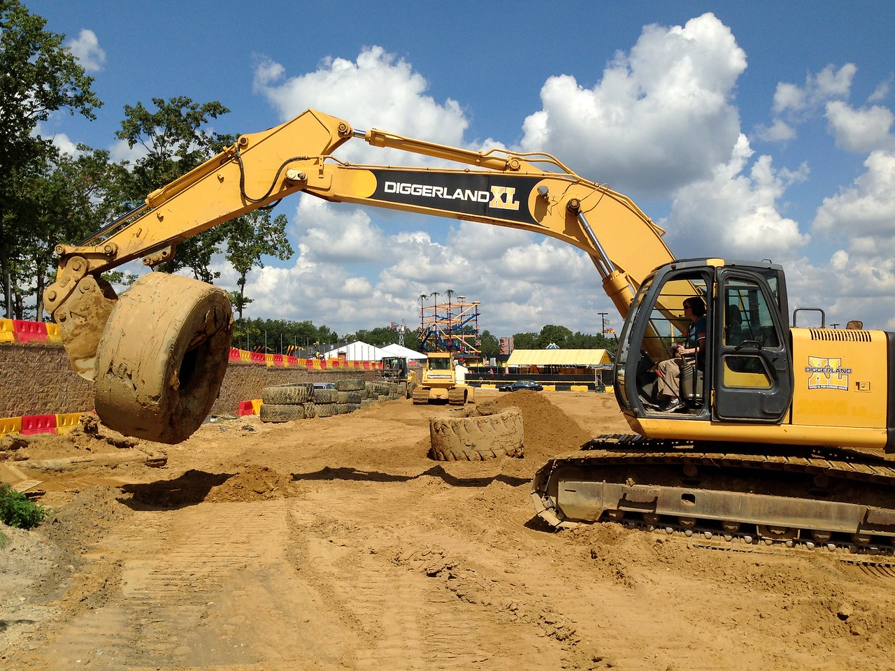 Snagged it!<br /> <br /> The excavator works by two joysticks, controlling arm reach, machine swivel, and bucket scoop and dump. Moving the machine is via two foot pedals that move the treads like a tank. Again, throttle sets the engine speed and stays there via a separate lever until you change something.