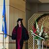Lisa walking to receive her diploma