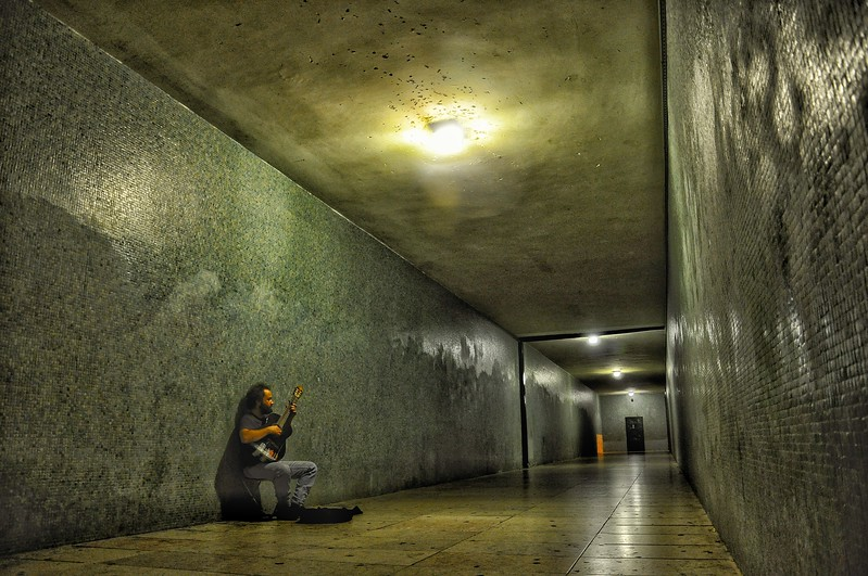 Musician busks in Tunnel. 2010.