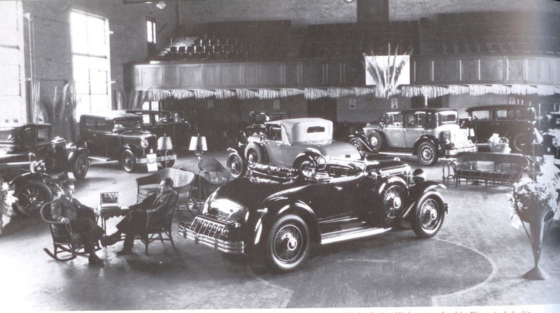 USA - Dealer / Salesman's Flip Chart - in use on table between the 2 seated people (Showroom with 1929 buicks on display)