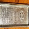 "BUICK RADIATOR TRAY:  Carl-Einar Mellander (25) sent me this photo of a small tray (130 x 75 mm -  5 in. x 3 in) shaped as a Buick 1929 radiator. ""I got it from the widow of the man who once sold the car to me in 1973.  She is well over 90 years old and went through her drawers looking at old memories."""