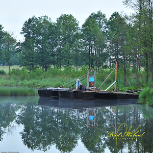 Boat used to extract Peat moss from lake to make it more usable for swimming and fishing.