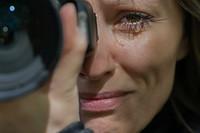 Photographer, crying.