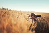 Photographer in field
