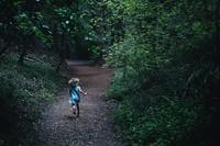 Child running through forest