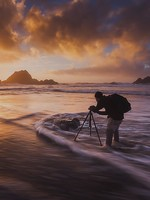 A photographer in the surf