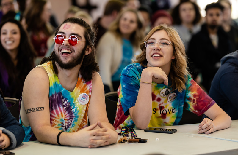 Manhattan High students Fin Huslig (left) and Kate Denny (right) watch drag queen Valaree Love as she performs at the Little Apple Pride Parade. Five drag queens performed on Saturday for a pavillion at Manhattan City Park full of individuals attending Little Apple Pride. (Olivia Bergmeier | Collegian Media Group)