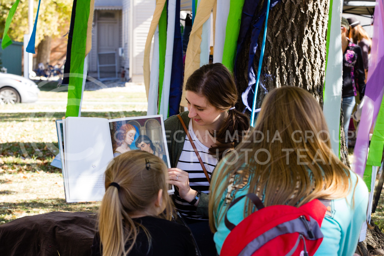 Jamie Teixeira reads to Children in the Childrens Reading Corner at the Little Apple Renaissance Fair on the 29th October, 2017 (Alex Shaw   Collegian Media Group)