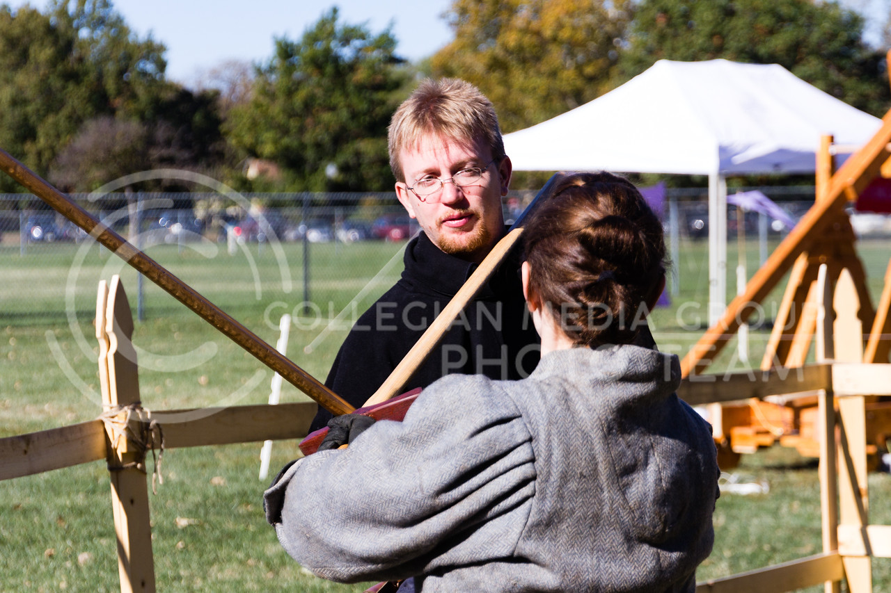 Robert Trigueros, and Amanda Zerrlaut practice sparring for a show put on by Broken-Arm Academy of Swordsmanship at Little Apple Renaissance Fair on the 29th October 2017 (Alex Shaw | Collegian Media Group)