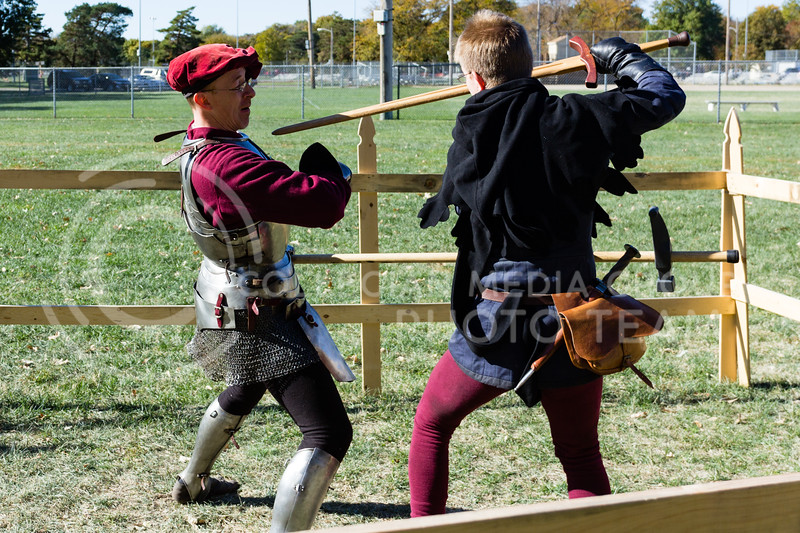Robert Trigueros, and Josh Warren practice sparring for a show put on by Broken-Arm Academy of Swordsmanship at the Little Apple Renaissance Fair on the 29th October 2017 (Alex Shaw | Collegian Media Group)