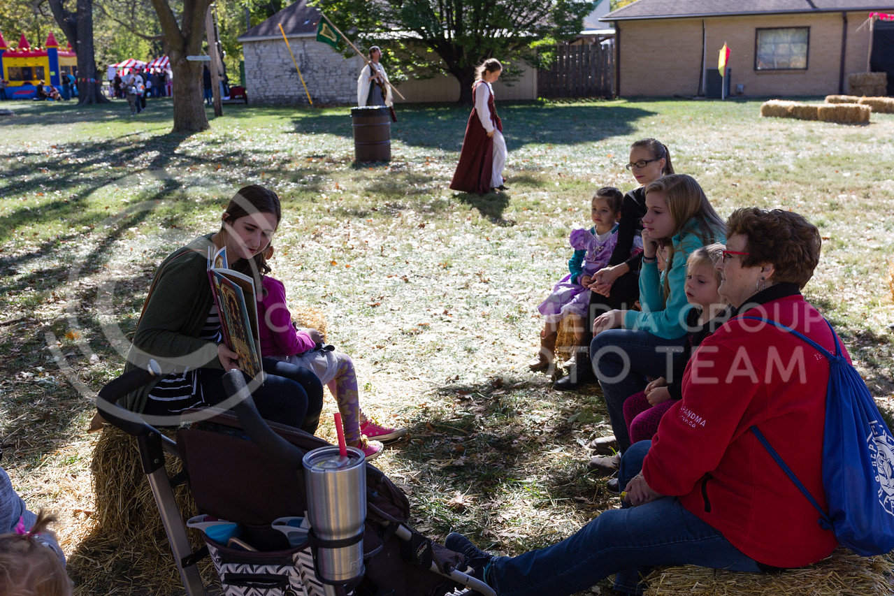 Jamie Teixeira reads to Children in the Childrens Reading Corner at the Little Apple Renaissance Fair on the 29th October, 2017 (Alex Shaw | Collegian Media Group)